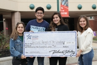 The Lone Star College students presented the grant money to Special Angels of The Woodlands on Dec. 9. (Courtesy Lone Star College Montgomery)
