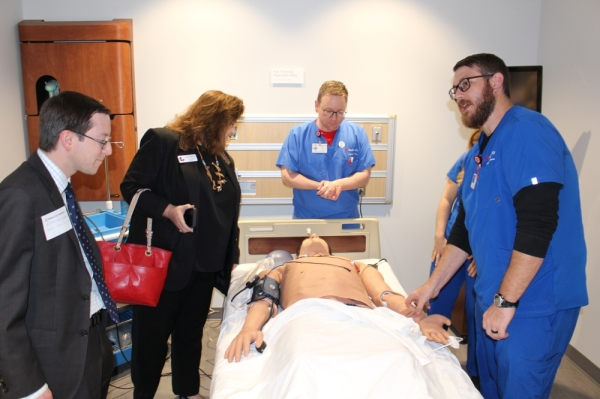 Plano Deputy Mayor Pro Tem Anthony Ricciardelli and Collin County Commissioner Susan Fletcher learn about the Center for Clinical Advancement's interactive mannequins. (William C. Wadsack/Community Impact Newspaper)
