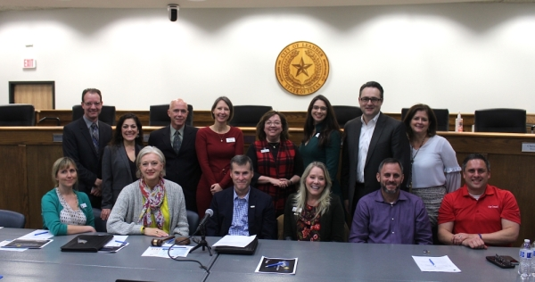 Members of the Leander City Council (seated) met with the Leander ISD board of trustees and Superintendent Bruce Gearing (standing) for a Feb. 11 joint meeting in Leander. During the nearly two-hour meeting, the elected bodies discussed common goals and challenges. (Brian Perdue, Community Impact Newspaper)
