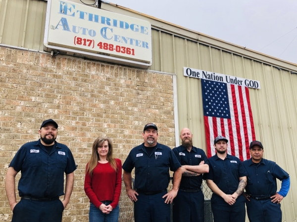 Owner Craig Tracy (third from left) and the staff of Ethridge Auto Center in Colleyville. (Photos by Ian Pribanic/Community Impact Newspaper)