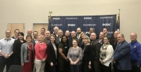Local leaders and community members involved in the implemention of the Pflugerville Community Development Corp.'s Comprehensive Economic Development Strategy 2.0 plan attended the PCDC's press conference Feb. 12. (Kelsey Thompson/Community Impact Newspaper)