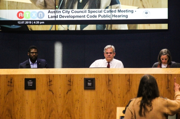 Austin Mayor Steve Adler (center), flanked by Assistant City Manager Christopher Shorter and City Attorney Ann Morgan, listen to public testimony on the land development code rewrite Dec. 7. (Christopher Neely/Community Impact Newspaper)