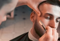 The men's salon offered a variety of services, including shaves. (Courtesy 18|8 Fine Men's Salon)