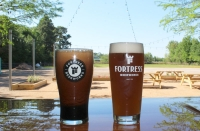 Fortress BeerWorks offers a taproom, featuring beers brewed on-site, as well as an outdoor patio and food trucks. (Eva Vigh/Community Impact Newspaper)