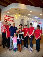Sgt. (Ret.) Mario Lopez and his family accept the check at Smoothie King. (Courtesy Amy Lohse)