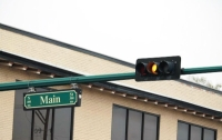 The city of Conroe has begun work to add flashing yellow lights to 26 locations across Conroe to make left turns safer for drivers. (Andy Li/Community Impact Newspaper)