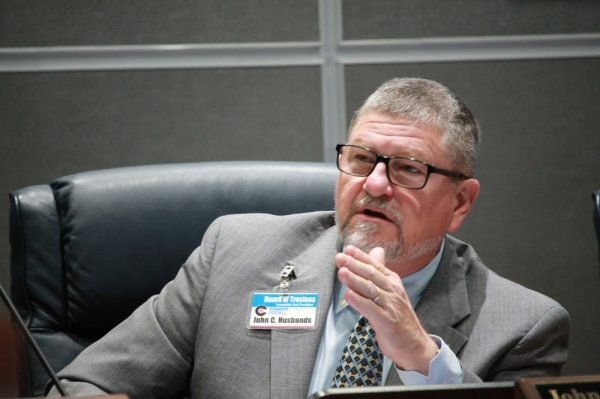 Conroe ISD trustee John Husbands voiced many concerns about the district's rezoning plan. (Andy Li/Community Impact Newspaper)
