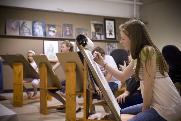 A photo of young adults creating artwork.