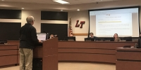 Robert Winovitch presented a change order request during a Feb. 19 board meeting. (Amy Rae Dadamo/Community Impact Newspaper)