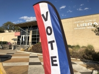 A sign guides voters inside at the George Washington Carver branch of the Austin Public Library during the fall 2019 election. (Jack Flagler/Community Impact Newspaper)
