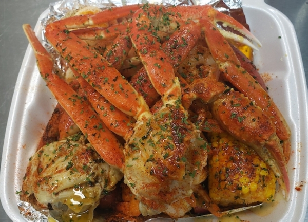 Krab Kingz Seafood's menu includes crab, shrimp, sausage, potatoes, corn and boiled egg, all seasoned in a signature boil. It also offers a garlic butter sauce that comes in five different flavors. (Courtesy Krab Kingz Seafood Cypress)