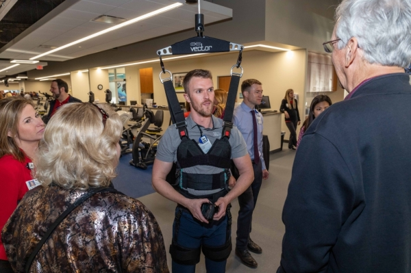Senior Occupational Therapist Aaron Coolidge, center, demonstrates unloading technology available to patients at the new clinic. (Courtesy Houston Methodist The Woodlands Hospital)