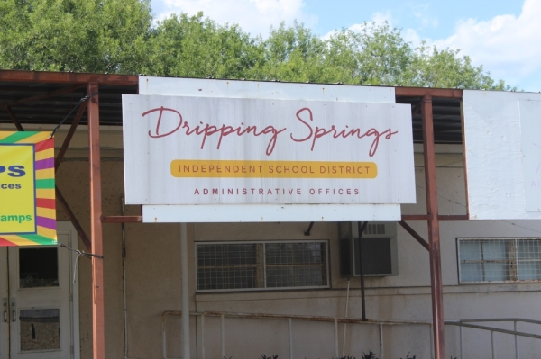 "A photo of a sign that reads ""Dripping Springs Independent School District Administrative Offices."""