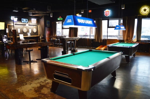 The Local Outpost always has something for its patrons to do with billiards tables, dart boards and live music on the weekends. (Iain Oldman/Community Impact Newspaper)