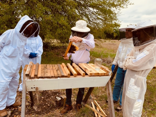 Les Crowder shows students the use of a top bar hive. The Central Texas Beginning Beekeepers School returns March 21. (Courtesy Central Texas Beekeepers Association)