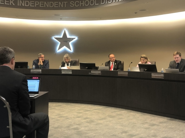 Steven Ebell (left) discussed the allocation of resources for English language arts and dual-language students with the Clear Creek ISD board of trustees at its regular meeting on Feb. 24. (Colleen Ferguson/Community Impact Newspaper)