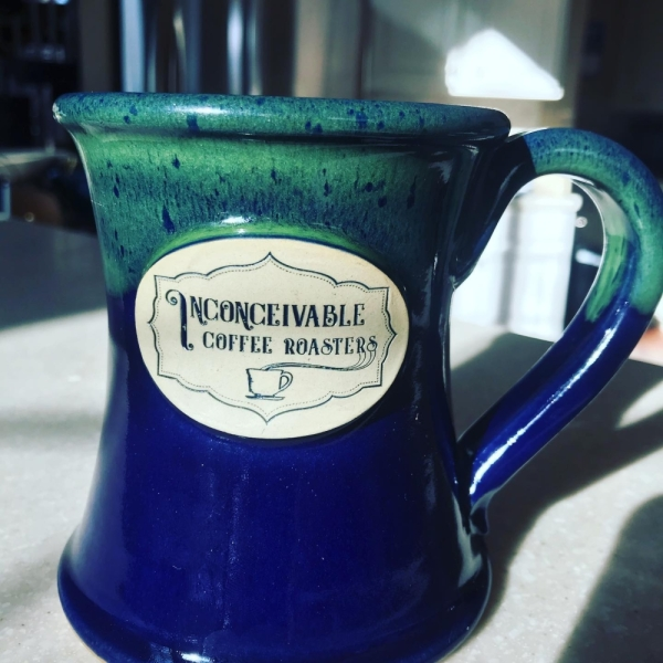 The business sells fresh, locally roasted coffees as well as apparel and coffee mugs. (Courtesy Inconceivable Coffee Roasters)