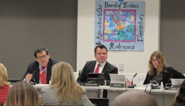 Austin ISD board President Geronimo Rodriguez (left) sits next to Superintendent Paul Cruz at a Feb. 24 board meeting. (Nicholas Cicale/Community Impact Newspaper)
