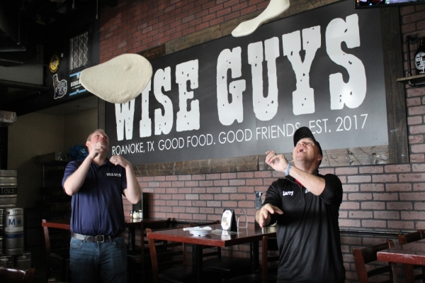 Wise Guys Pizzeria owners Kevin McNamara and Larry McCain said they know all of the ins and outs of the business. (Ian Pribanic/Community Impact Newspaper)