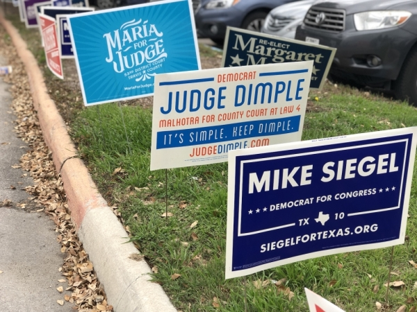 Candidate signs line the road leading into Austin Community College's Highland campus on Feb. 23 during the early voting period in Travis County. Jack Flagler/Community Impact Newspaper