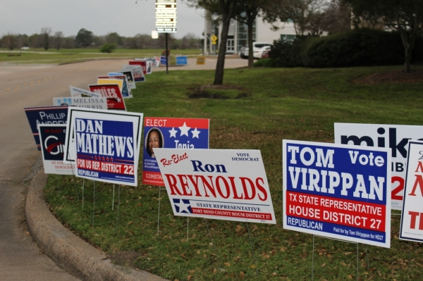 Candidates, including those running for Texas House District 27, advertise on signs outside of Missouri City City Hall. (Claire Shoop/Community Impact Newspaper)
