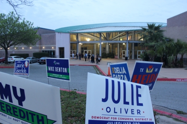 Voters at the Millennium Youth Entertainment Complex walked past candidate signs to vote on the morning of March 3 in East Austin. Jack Flagler/Community Impact Newspaper