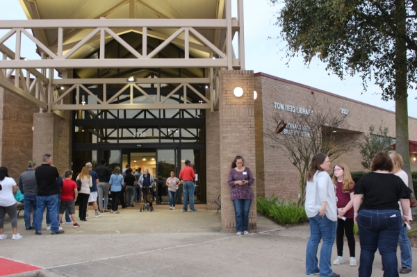 Voters were waiting in line to vote at the Brazoria County polling location on Tuesday night.