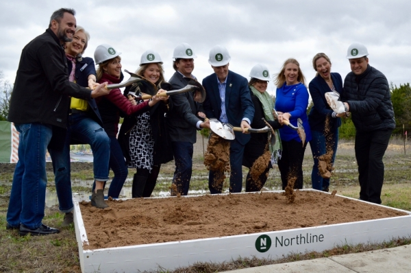 Leander City Council, developer Alex Tynberg, Williamson County Commissioner Cynthia Long and Leander Chamber of Commerce President Bridget Brandt broke ground at Northline on March 4. (Taylor Girtman/Community Impact Newspaper)