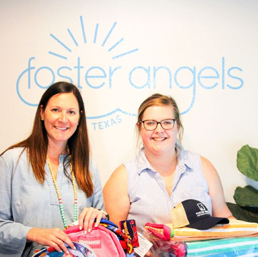 Tania Leskovar-Owens (left) and Maggie Sheppard pose with some of the items they will give to foster children in Central Texas. (Brian Rash/Community Impact Newspaper)