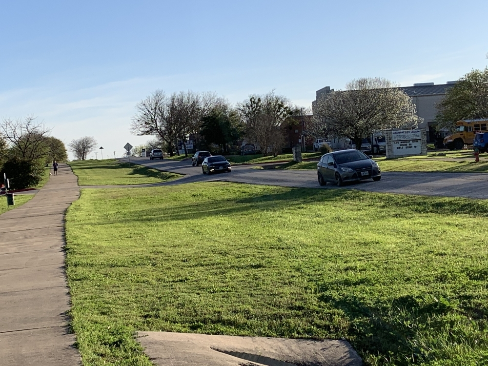 The reconstruction of the two-lane road will include the elimination of a low-water crossing near Heritage Park and the addition of a roundabout where the road curves toward FM 682. (Chase Karacostas/Community Impact Newspaper)