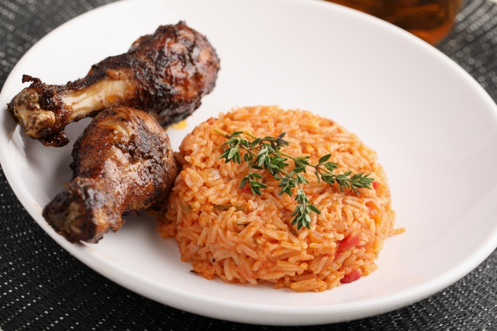 Fusion Vibes Kitchen + Bar will serve dishes like suya wings and jollof rice. (Courtesy Adobe Stock)