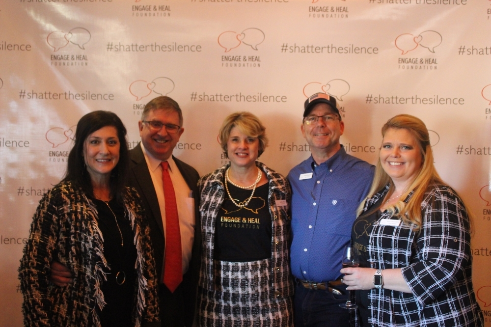 (From left to right) Kathleen Hassenfratz, Tom Kilgore, Amelia Floyd, David Sheenan and Kerri Elliott attend the Bubbles and Bags Luncheon Feb. 27. (Amy Rae Dadamo/Community Impact Newspaper)