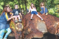 Guests can travel back to prehistoric times and come face to face with life-size, animatronic dinosaurs at Jurassic Gardens and Dinos After Dark. (Courtesy Grapevine Department of Parks and Recreation)