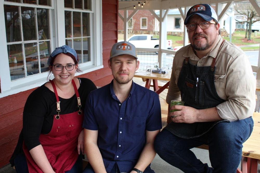 Pastry chef Megan Allen (left), General Manager Josh Read (middle), and chef and partner Mix McCrory (right) opened 7 Acre barNgrill in April 2019. (Kara McIntyre/Community Impact Newspaper)