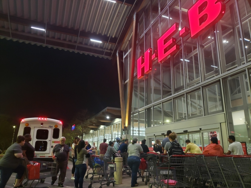 Customers in Austin wait for H-E-B to open March 13. (Ali Linan/Community Impact Newspaper)