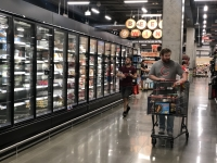 Shoppers in a Houston area store survey the products at H-E-B this week. (Nola Valente/Community Impact Newspaper)