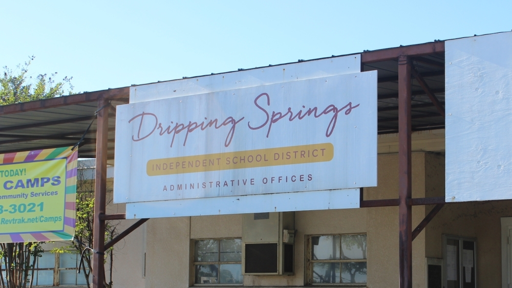 "A photo of a sign that reads ""Dripping Springs Independent School District Administrative Offices"""