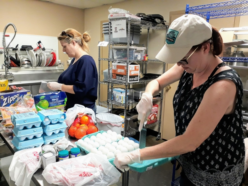 Volunteers from the Cypress Area Eats Facebook group sort grocery donations and purchases to deliver to their neighbors. (Courtesy Cypress Area Eats)
