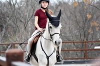 Riley Conlin takes a jumping lesson on horse Setesh. (Makenzie Plusnick/Community Impact Newspaper)