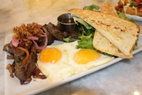 Vietnamese Steak & Eggs ($14.99) from Toast Breakfast Brunch Lunch is made with locally sourced, marinated, center-cut top sirloin and served with two eggs, a side salad and La Baccia toast. (Beth Marshall/Community Impact Newspaper)