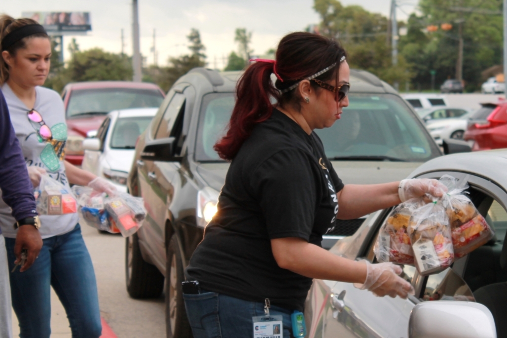Conroe ISD volunteers distributed about 60,000 meals March 17 and March 19, according to Superintendent Curtis Null. (Andy Li/Community Impact Newspaper)