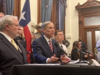 Dr. John Hellerstedt, commissioner of the Texas Department of State Health Services, left, and Gov. Greg Abbott addressed the media from the Texas Capitol on March 13. (Brian Rash/Community Impact Newspaper)