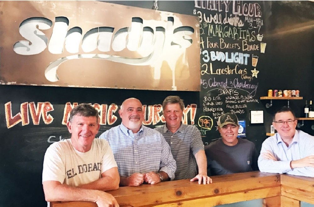 Co-owner of Shady's Burgers & Brewhaha Greg Cooney (left) is reporting a loss of revenue and employee furloughs due to the coronavirus. (Olivia Lueckemeyer/Community Impact Newspaper)