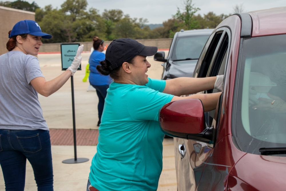 NBISD workers deliver meals to students at the Veramendi Elementary School meal pickup location March 17. (Courtesy New Braunfels ISD)