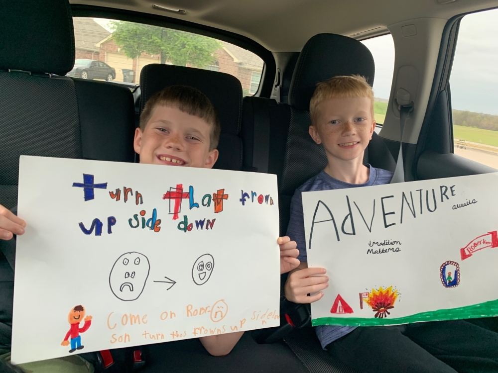 Two students whose mother works for Robertson Elementary School made signs to bring for the car parade. (Courtesy Kyla Prusak)