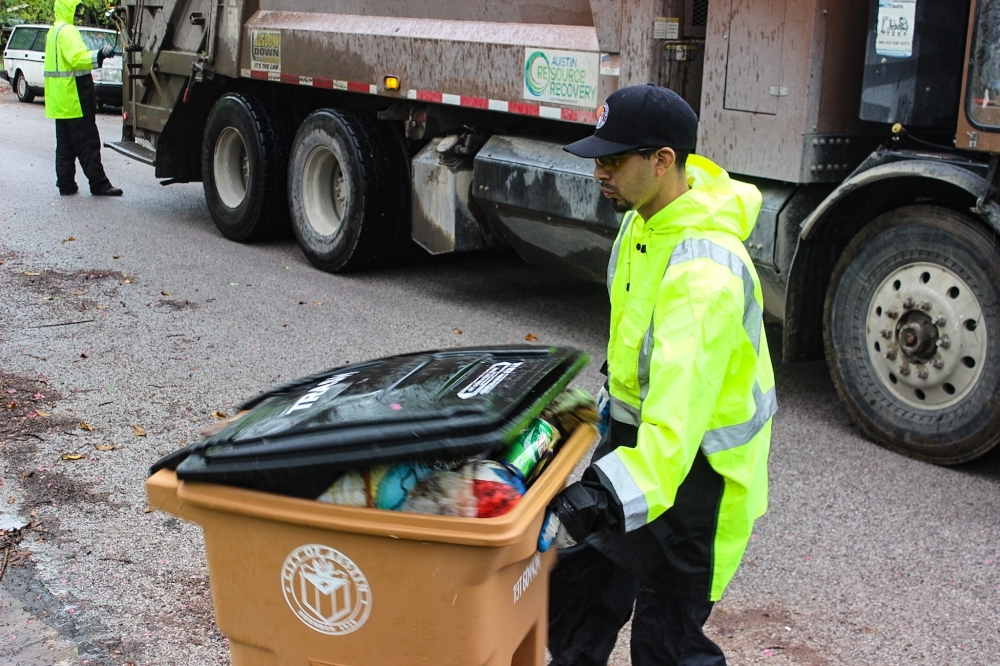 Manny Lopez continues to pick up trash five days a week even amid the global coronavirus pandemic. (Christopher Neely/Community Impact Newspaper)