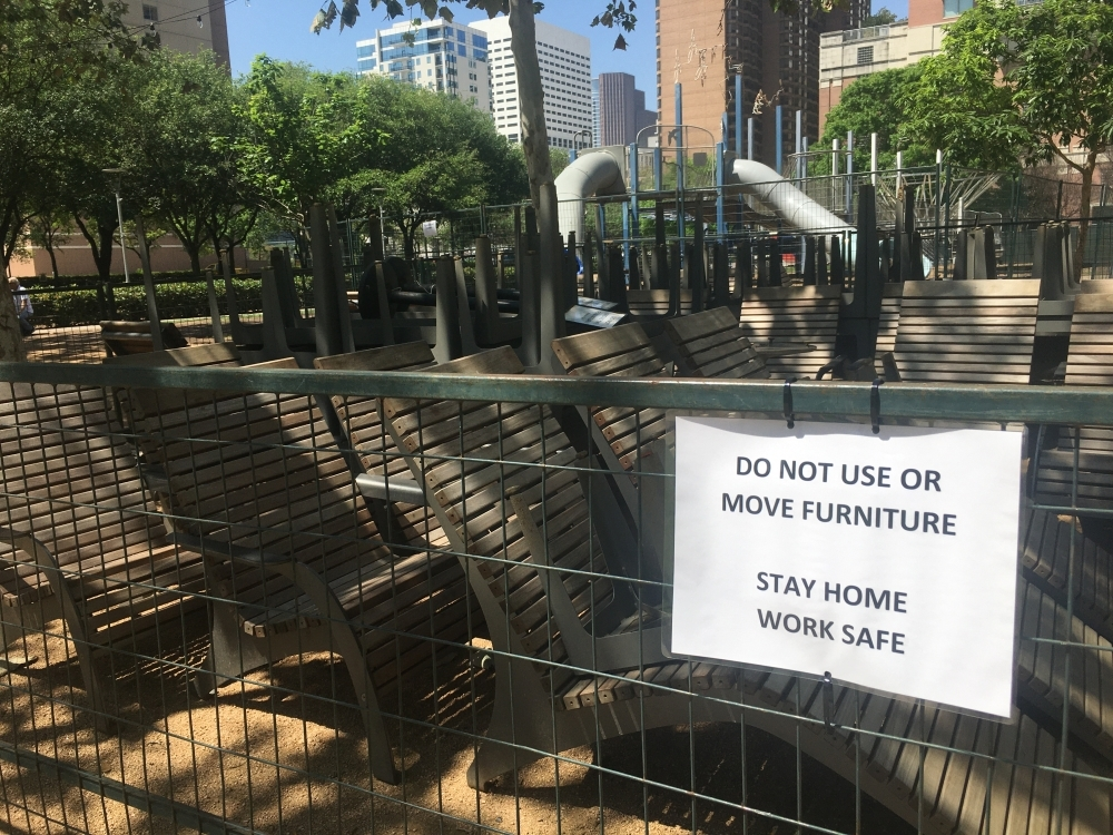 "Discovery Green is still open in Houston, but a playground has been closed off, and visitors are not allowed to use the furniture under Harris County's new ""Stay Home-Work Safe"" order. Only a handful of visitors were at the park March 25. (Shawn Arrajj/Community Impact Newspaper)"