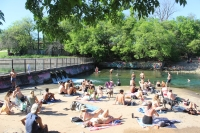 With heavy restrictions on public gatherings in place, sizable crowds gathered on the free side of Barton Springs pool March 24, only hours before Austin's stay-at-home order went into effect. (Christopher Neely/Community Impact Newspaper)