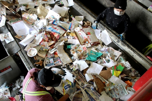 Workers sort through recycled material in Chandler. (Alexa D'Angelo/Community Impact Newspaper)