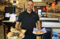 Manny Yiakras has been running Manny's Greek Cafe on Hwy. 6 in Cy-Fair since 2004. (Shawn Arrajj/Community Impact Newspaper)